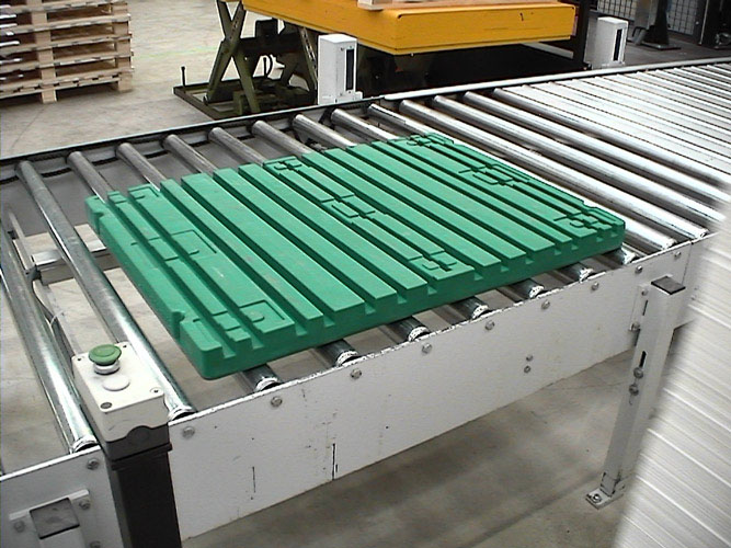 Plastic Press Pallet Board on Conveyor