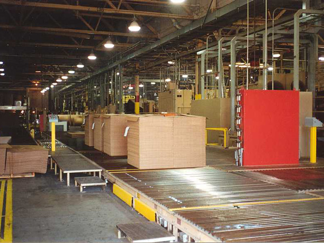Sheets Travel on Conveyor Toward Strapper